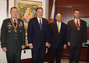 Teodoro with Ambassador Gaa and two US defense officials. Photo grabbed from Philippine Embassy website.