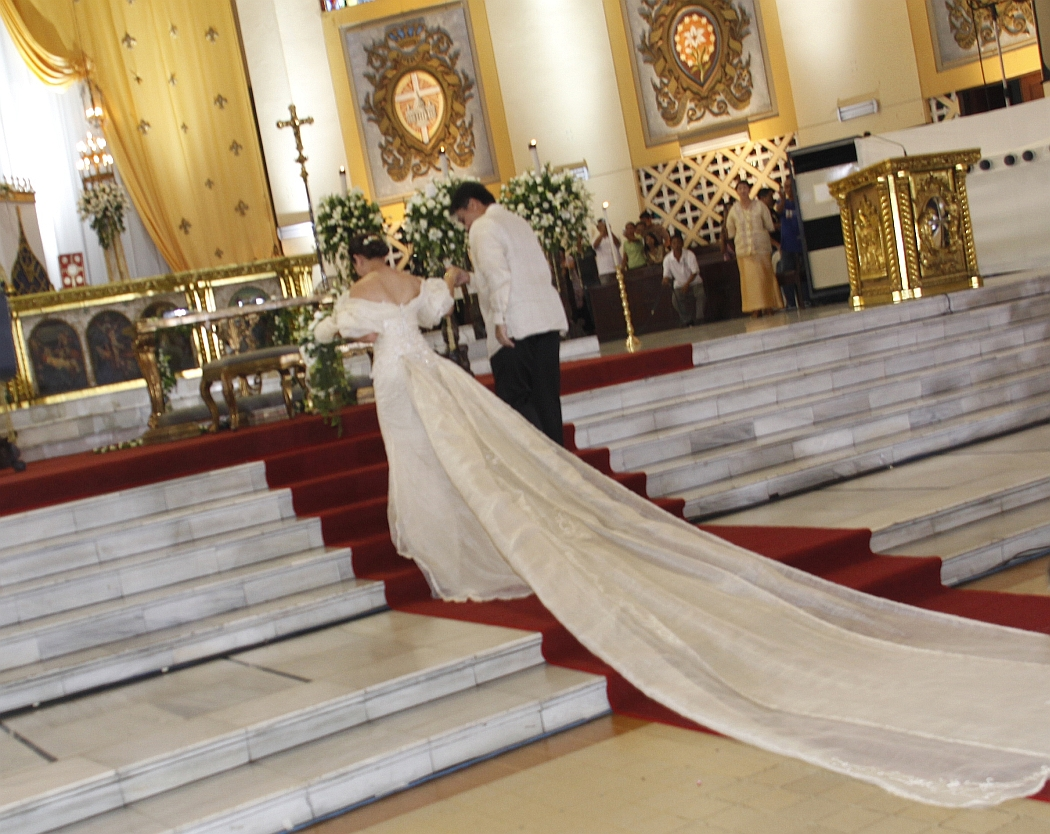 The bride and groom take their places in front of the altar at Santo Domingo Church.