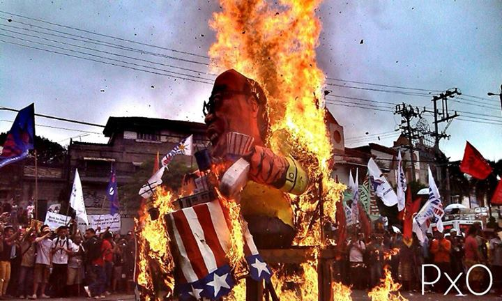 Outside the Batasang Pambansa where Mr. Aquino delivered his longest SONA, protesters burn an effigy of him. (Pixel Offensive)