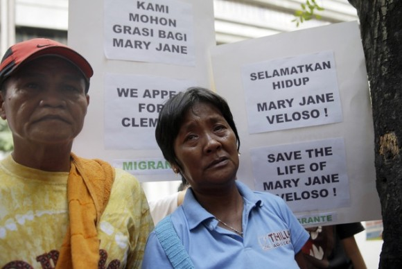 Cesar and Celia Veloso, parents of convicted drug trafficker Mary Jane Fiesta Veloso, wait outside the Indonesian Embassy at the financial district of Makati city, east of Manila, Philippines to deliver an open letter addressed to Indonesian President Joko Widodo Wednesday, April 8, 2015. In the open letter, the Veloso family is asking for clemency to save the life of Mary Jane Fiesta Veloso who was convicted for drug trafficking in Indonesia and is sentenced to be executed after her appeal was rejected by the Indonesian Supreme Court March 26. (AP Photo/Bullit Marquez)